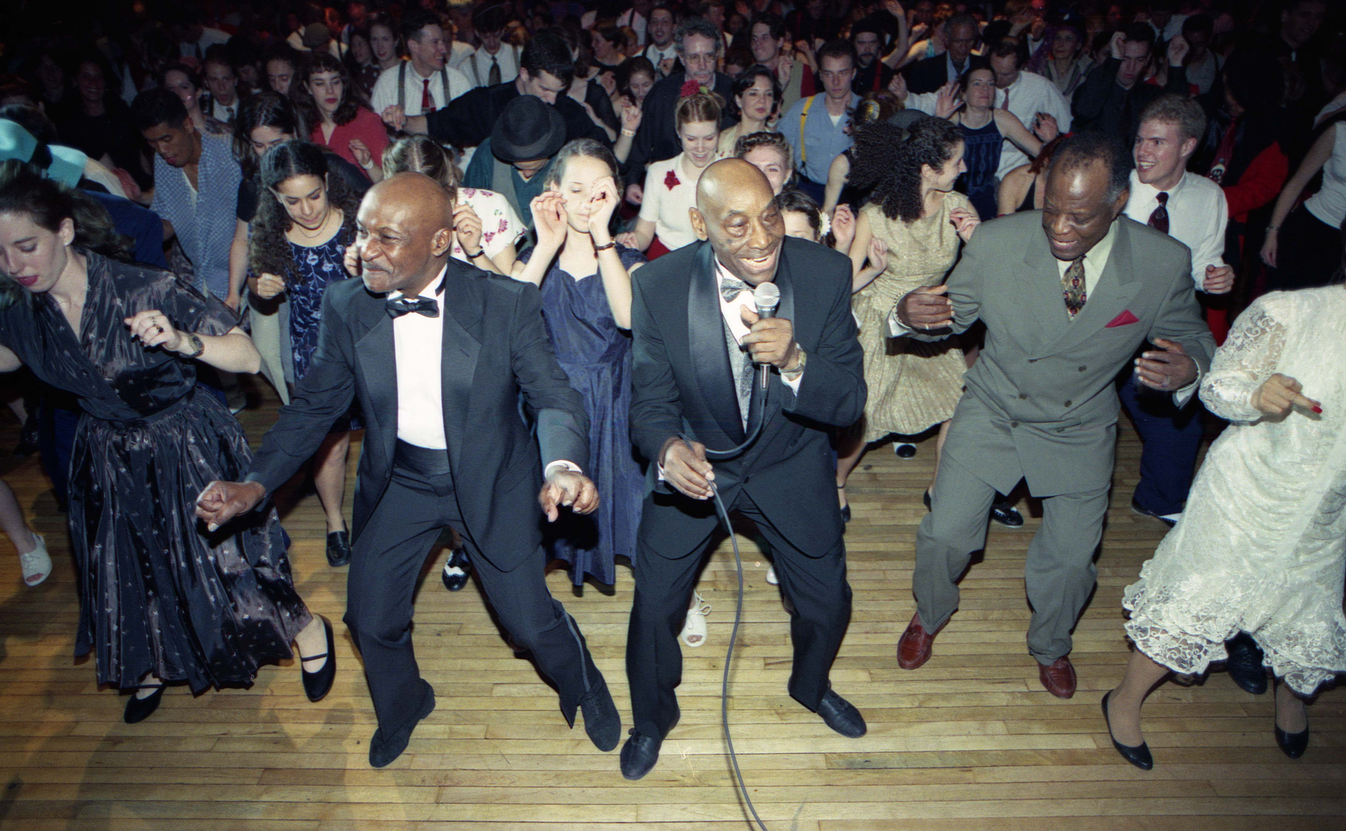 Frankie Manning Calling the Shim Sham at this 85th Birthday Celebration at Roseland Ballroom in 1999 - Recorded in Swingin' Away.  With Chazz and Charlie.